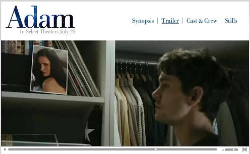 Still from the film 'Adam'-- Adam looking at photo