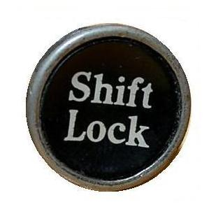 Shift Lock key from manual typewriter, linking to book 'The Philosopher's Gaze'