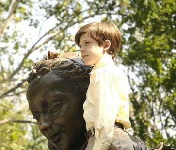Image-- From the film 'Joshua,' Joshua with the Alice statue in Central Park