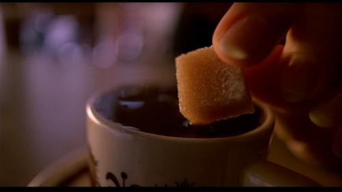 Image-- Sugar cube in coffee, from 'Bleu'