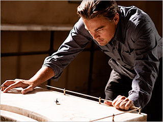 IMAGE- Leonardo DiCaprio with totem top in 'Inception'