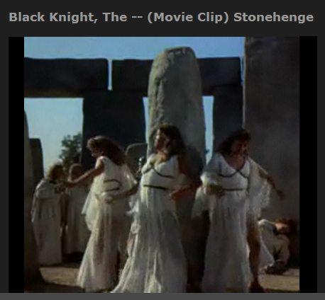 IMAGE- Phallic post at Stonehenge with dancing girls, 'The Black Knight,' 1954