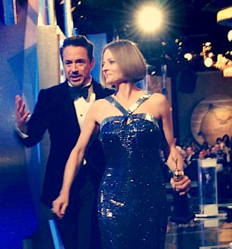 IMAGE- Robert Downey Jr. and Jodie Foster exit the stage at the 2012 Golden Globe Awards