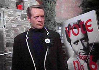 IMAGE- Patrick McGoohan as 'The Prisoner,' with lapel button that says '6.'