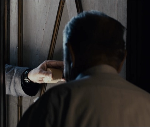 Image- Bread at the church door in 'Certified Copy'