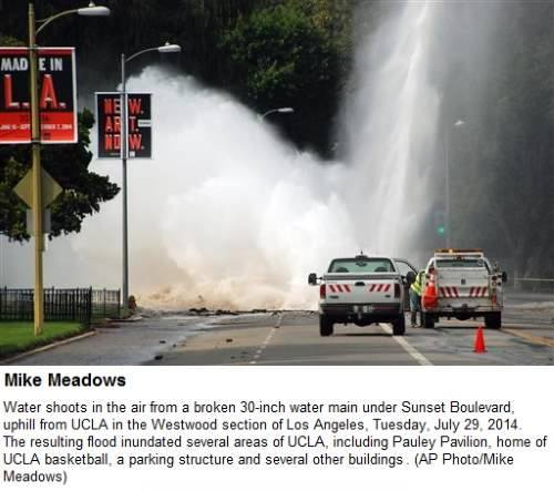 IMAGE- 'MADE IN LA,' 'NEW ART NOW,' with fountain from broken water main on Sunset Boulevard. Photo by Mike Meadows.